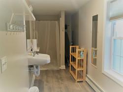 Bathroom 1 shower off living room