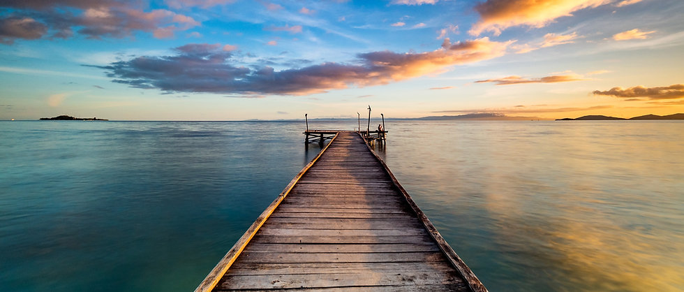 Beautiful shot of a long jetty_pier at sunset. Minimal image with jetty in the center stre