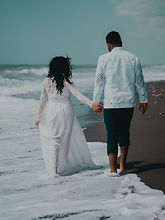 man%2520and%2520woman%2520holding%2520hands%2520while%2520walking%2520on%2520beach%2520during%2520da