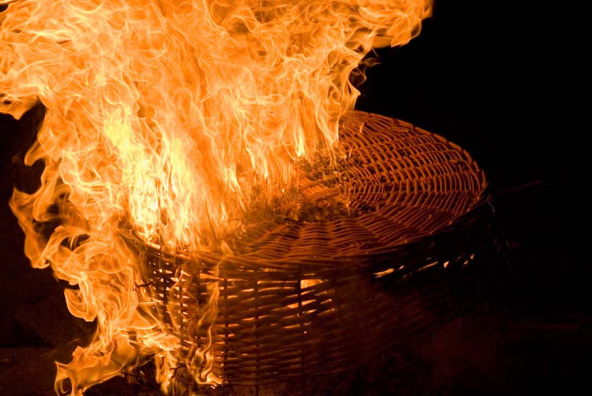 Picture of a basket burning with a LOT of flames.