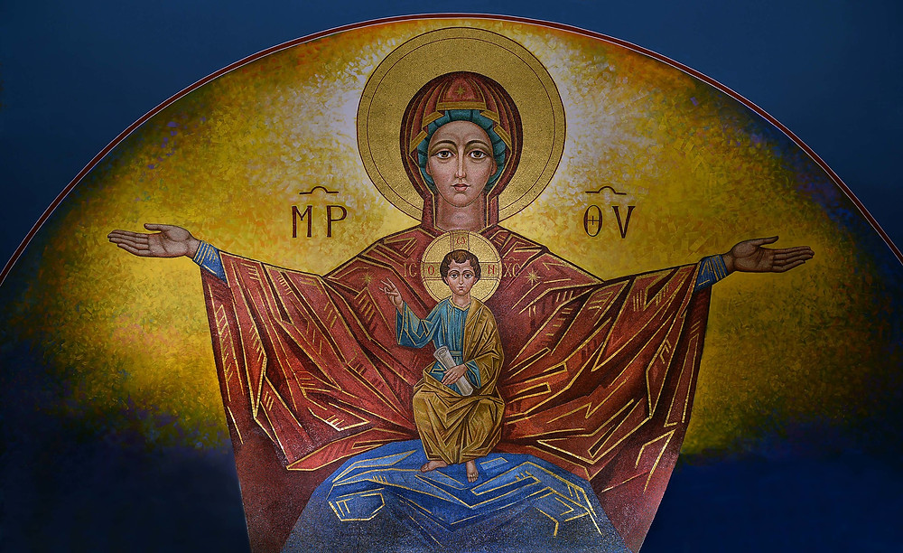 Icon of Mary and Jesus, known as Theotokos. She has her arms extended, and the child is on her lap.
