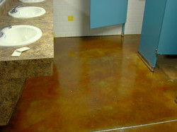 Tan stained concrete bathroom