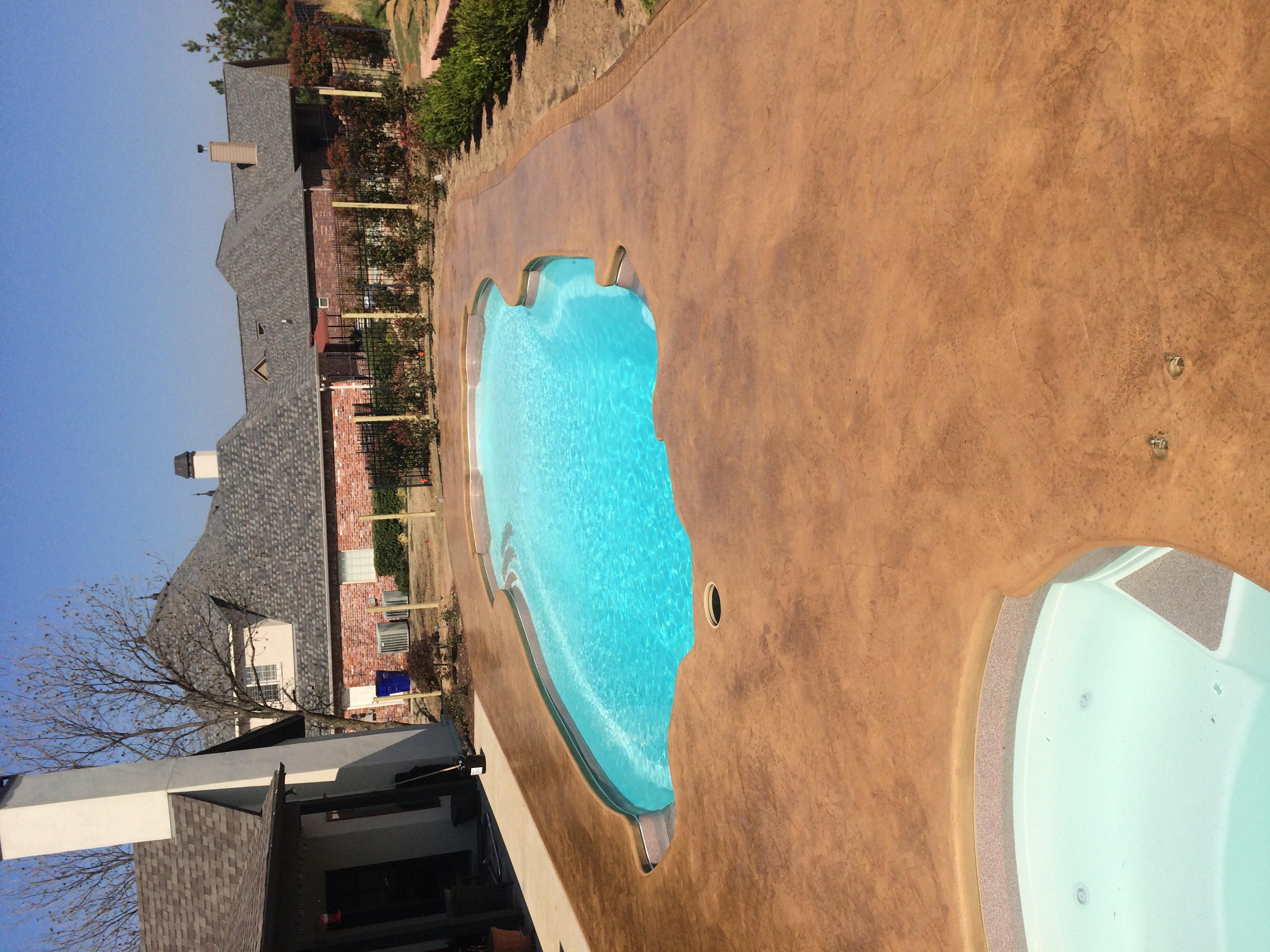 Stamped & stained pool deck in Tulsa