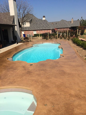 Stamped and acid stained concrete pool deck in Catoosa
