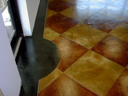 Black, Tan and Red Stained Concrete