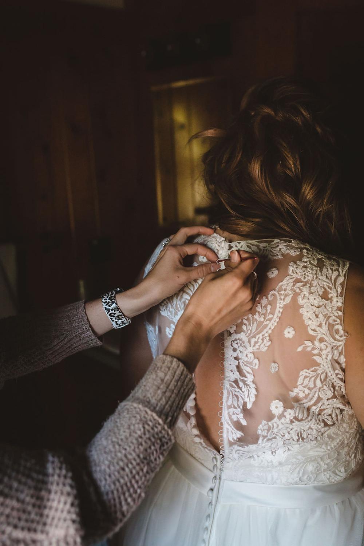 Bride getting ready at the Izaak Walton Inn