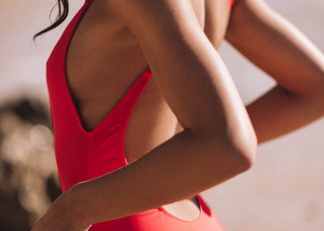 red swimsuit made from ocean plastic was