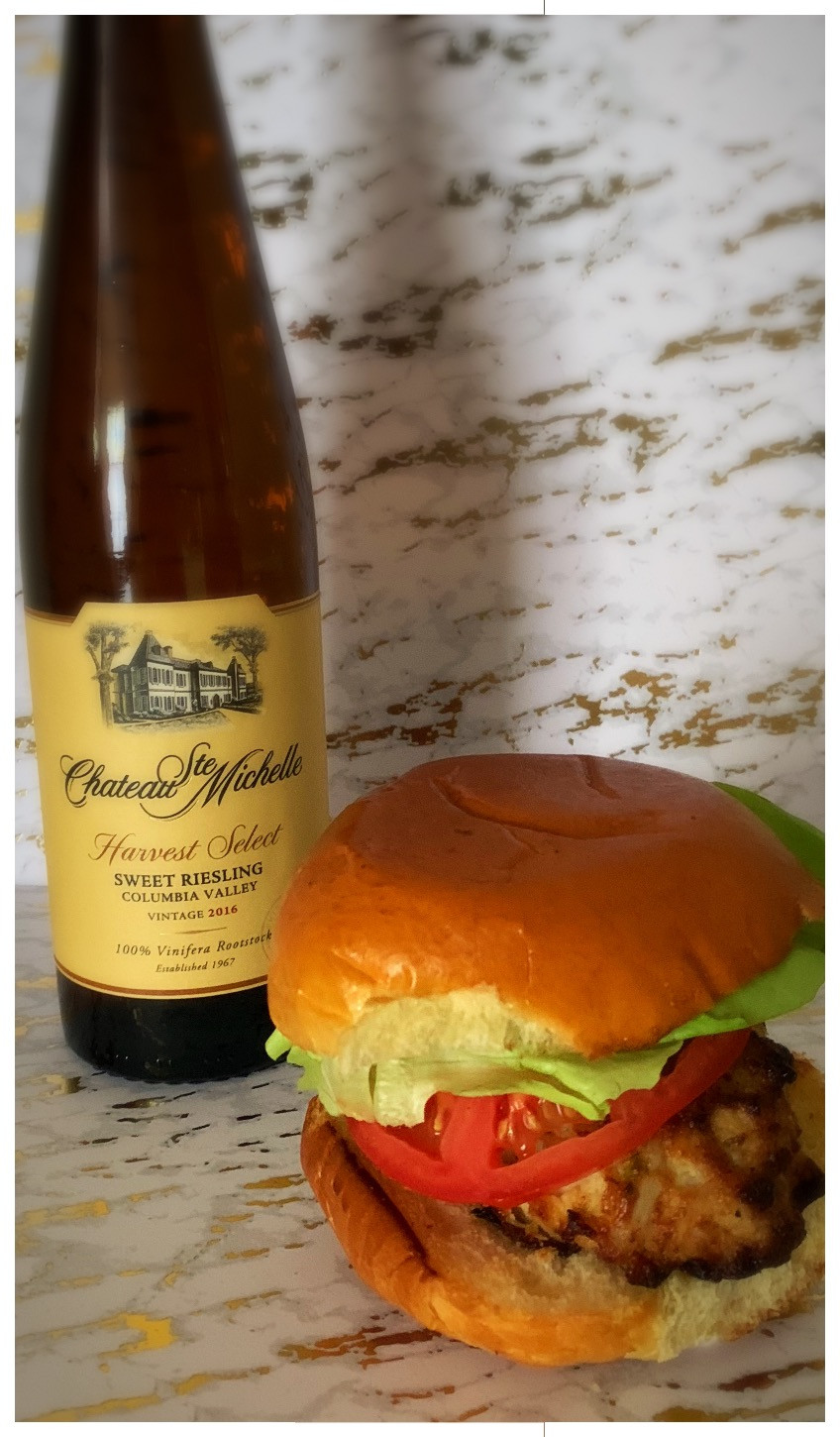 Sweet Riesling & crab cake sandwich with tomatoes, lettuce, and aioli sauce