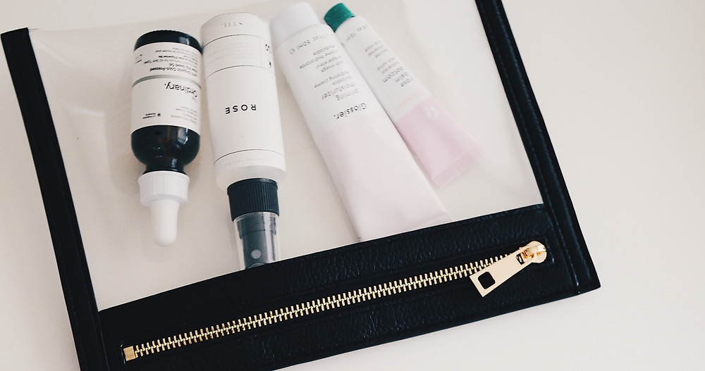 skincare products in travel bag