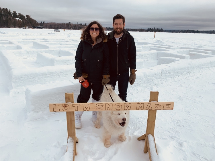 Photo by Kim Leduc, Q104, Jacki and Derek, The Roving Route, Posing for the LOTW Snow Maze with their dog Tika