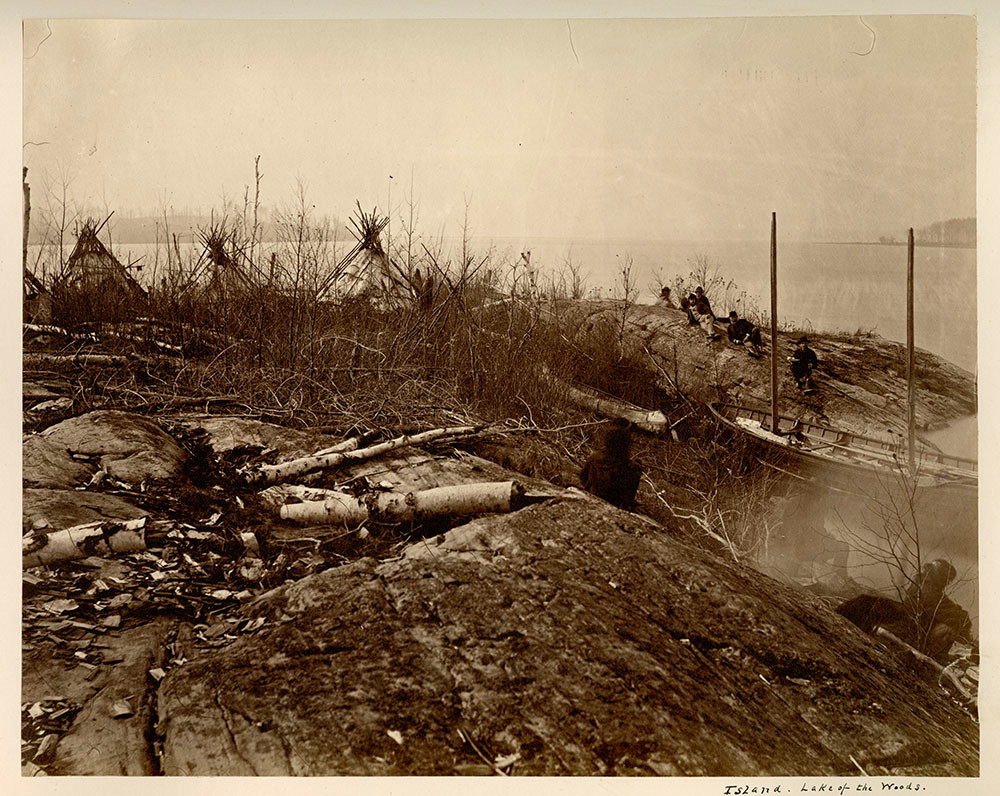 Wigwams on an island in Lake of the Woods in 1872. Photo from KIINAWIN KAWINDOMOWIN STORY NATIONS