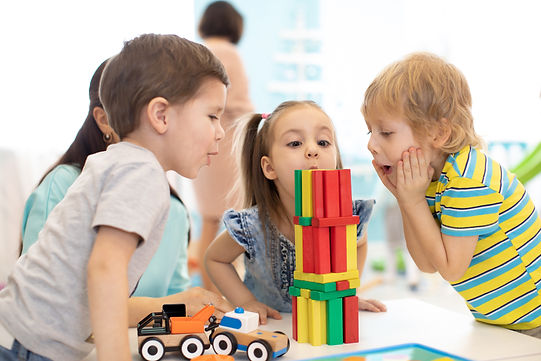 Little kids build wooden toys at home or