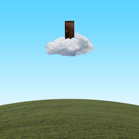 """""""Wood door on cloud over grassland field"""""""