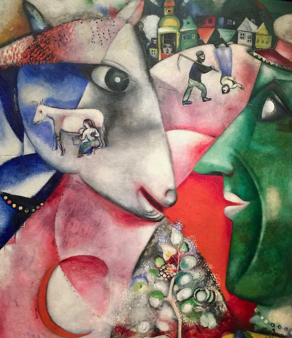 Painting: I and the Village by Marc Chagall with animal and person gazing into each other's eyes. Woman milking a cow