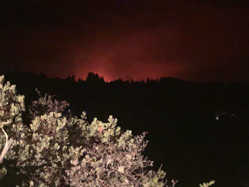 Fire glow from CZU Lightning Complex Fire near Alba Rd outside of Ben Lomond, California
