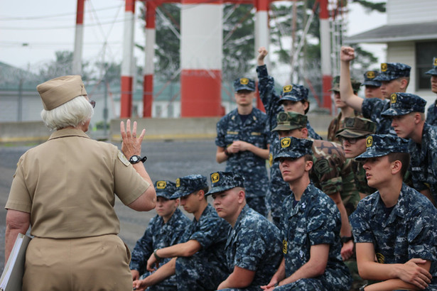 A volunteer details training information to cadets.