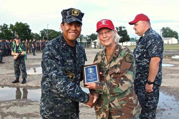 A staff cadet receives an award at summer training.