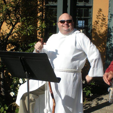 Christopher Putnam, playing washtub bass with the Angel Band, All Souls Parish