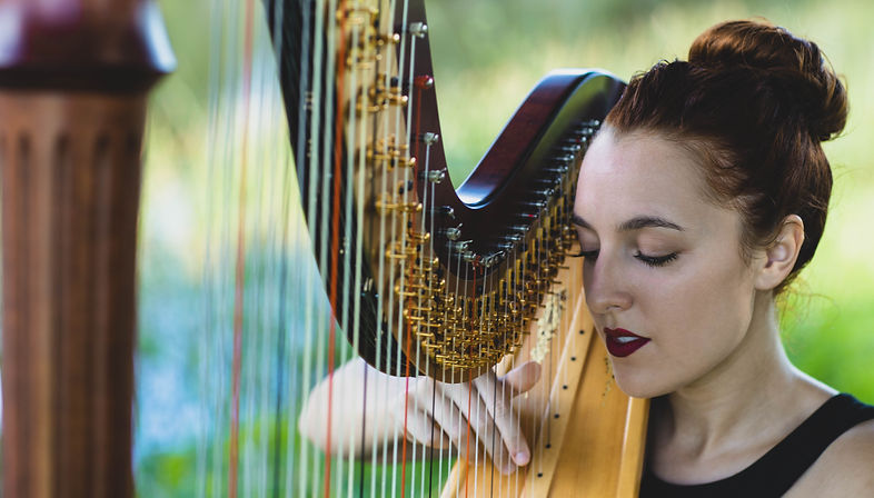 Harpist Natalie Wagner playing her pedal harp
