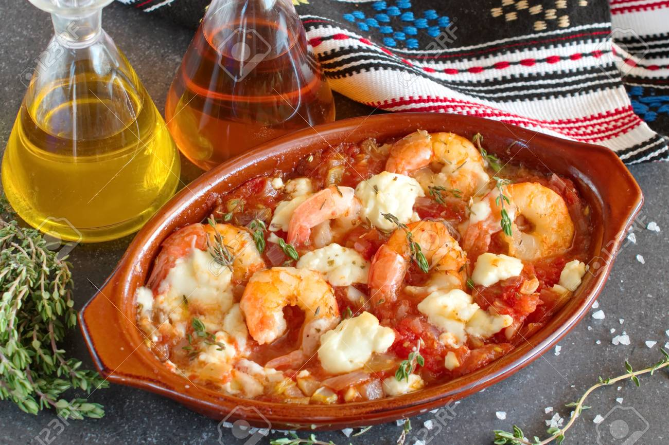 85208207-greek-traditional-food-oven-backed-prawns-with-feta-tomato-paprika-thyme-in-a-traditional-c