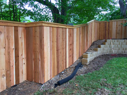 Vertical wood privacy fence with cap and trim made by Austin Brothers Fence Co.