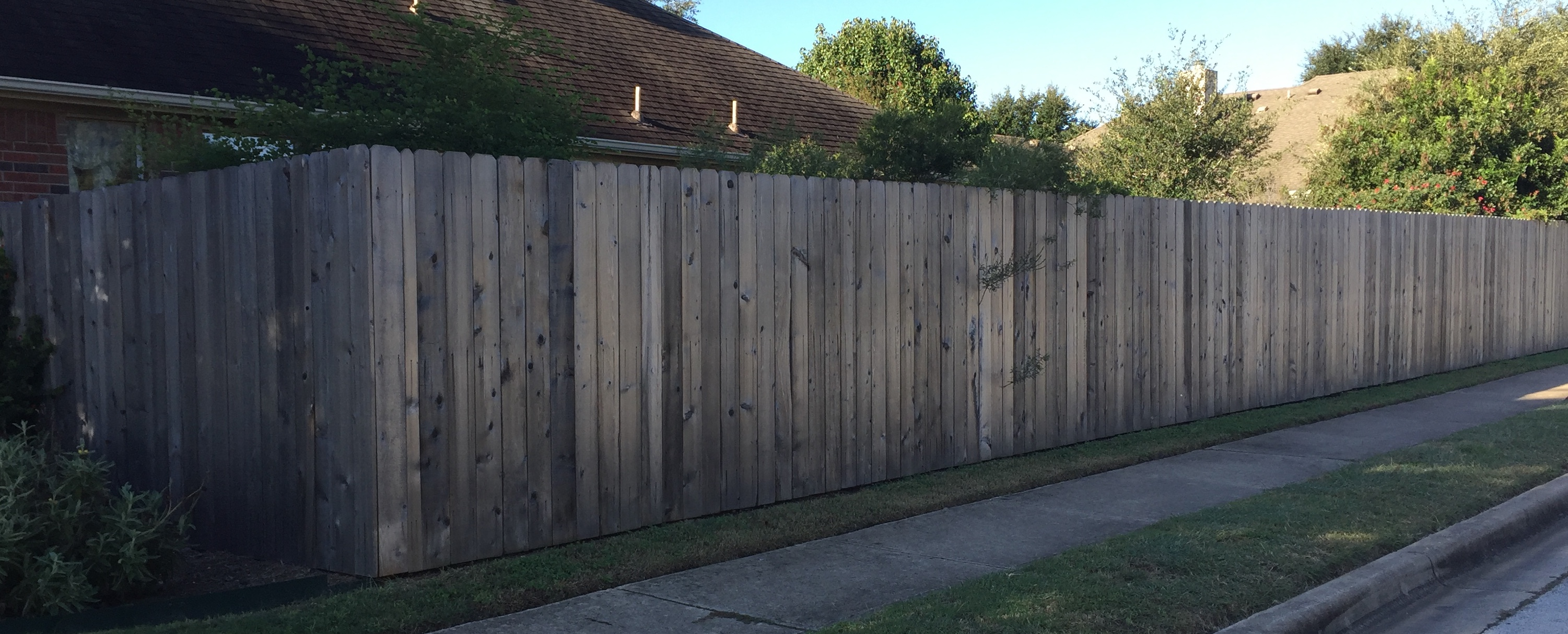 Austin brothers fence company quality fence installation private wood fence with vertical pickets and grey stain by austin brothers fence co baanklon Image collections