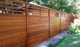 Horizontal privacy fence with semi-private top by Austin Brothers Fence Co.
