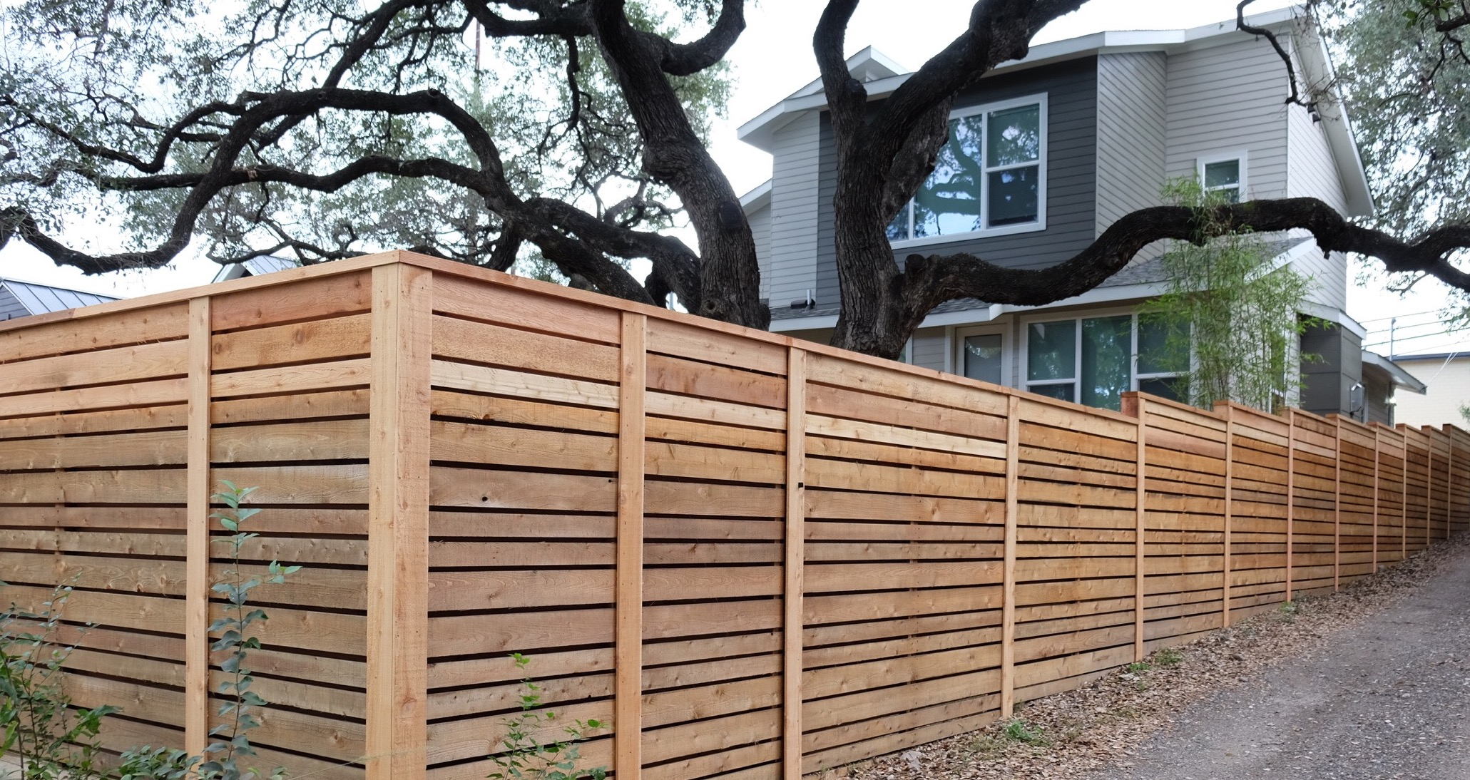 Austin brothers fence company quality fence installation semi private wood fence with horizontal alternating picket design and trim made by austin brothers fence co baanklon Image collections
