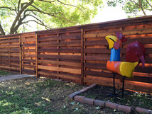 Horizontal shadow box fence with steel posts by Austin Brothers Fence Co.