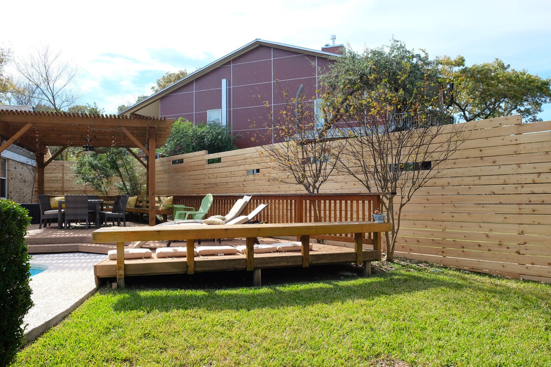 "Modern-build horizontal fence with window feature and 5/4"" cedar pickets made by Austin Brothers Fence Co."