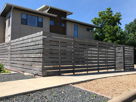 Horizontal semi-privacy fence made by Austin Brothers Fence Co.
