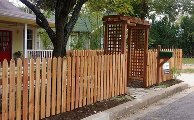 Vertical semi-privacy fence with trellis arbor made by Austin Brothers Fence Co.