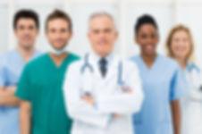Smiling team of doctors and nurses at hospital.jpg