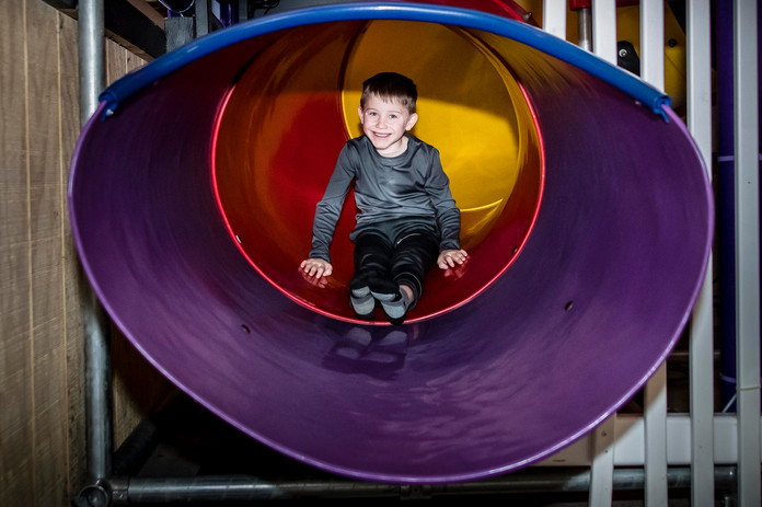 Boy on slide at Hickory Falls Family Fun Center