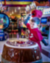 Boy playing arcade game at Hickory Falls, home to over 30 video and arcade games, plus go-karts, virtual reality, mini bowling and more.