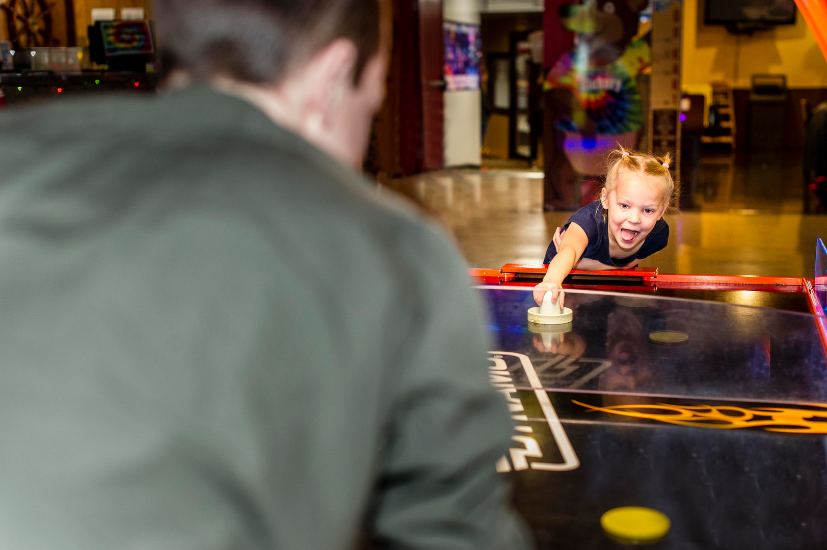 Little girl having fun playing an arcade game at Hickory Falls