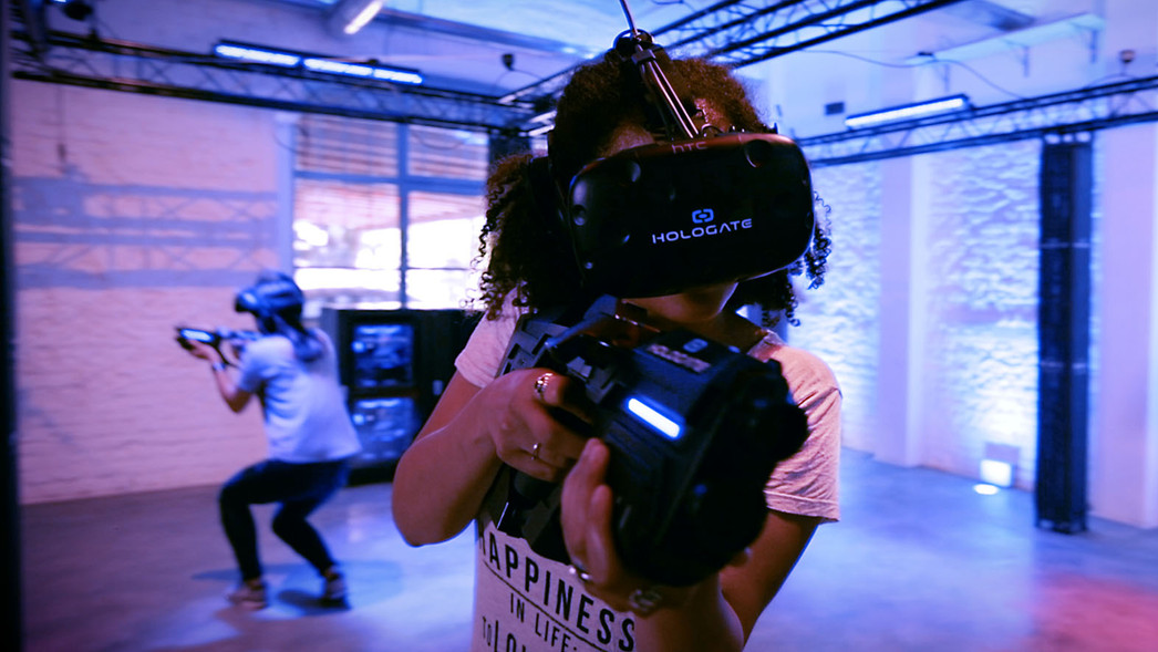 Guests playing Hologate, virtual reality game, at Hickory Falls