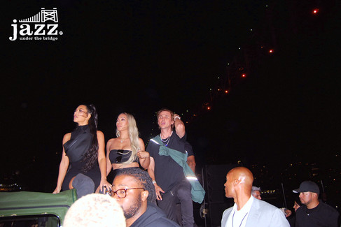 Kim Kardashian supports husband Kanye West under the Queensboro Bridge