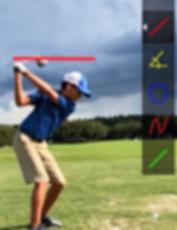 Golf instruction with a junior golfer using CaddieBasket PRO on their handheld device.