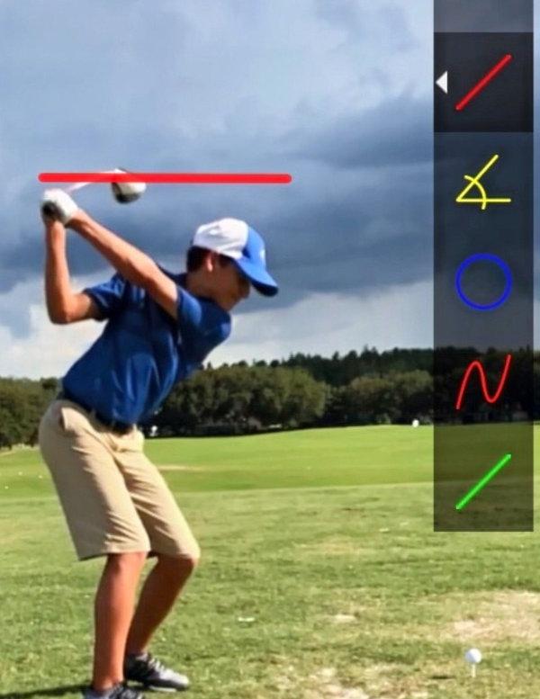 Golf instruction with a junior golfer using CaddieBasket PRO on their handheld device.