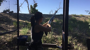 woman shooting shotgun at Kiowa creek sporting clays, skeet, trap