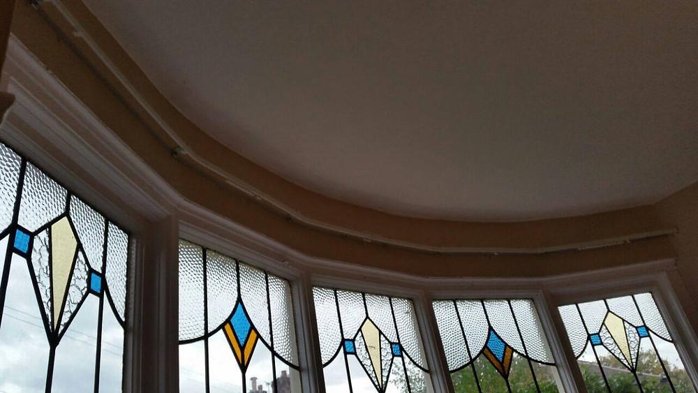 5 window pane (gentle curve) bay window - aluminium curtain trackbespoke fitted by Leo