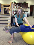 A Child working on strength in physical therapy