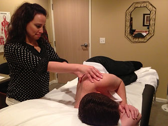Physical therapist working hands on with a patient