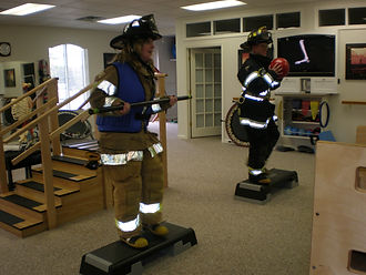 Firefighter performing exercises in his gear