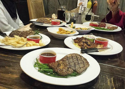How do I like my steak_ Next to my other steaks