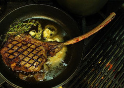 Oh just a 1.jpg Tomahawk beef steak that's too big to fit all the way in a cast iron skillet._⠀⠀⠀⠀⠀⠀