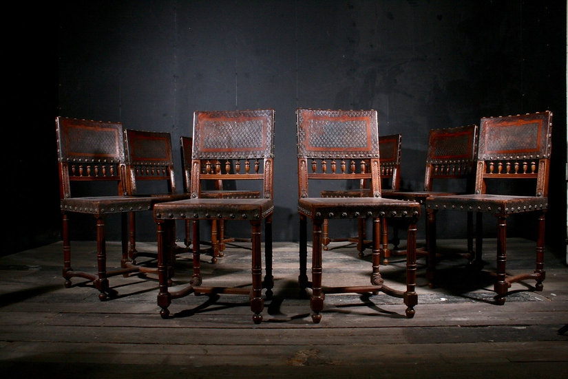 Eight Leather Dining Chairs