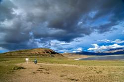 solo-female-cyclist-and-tibetan-lake-PDB