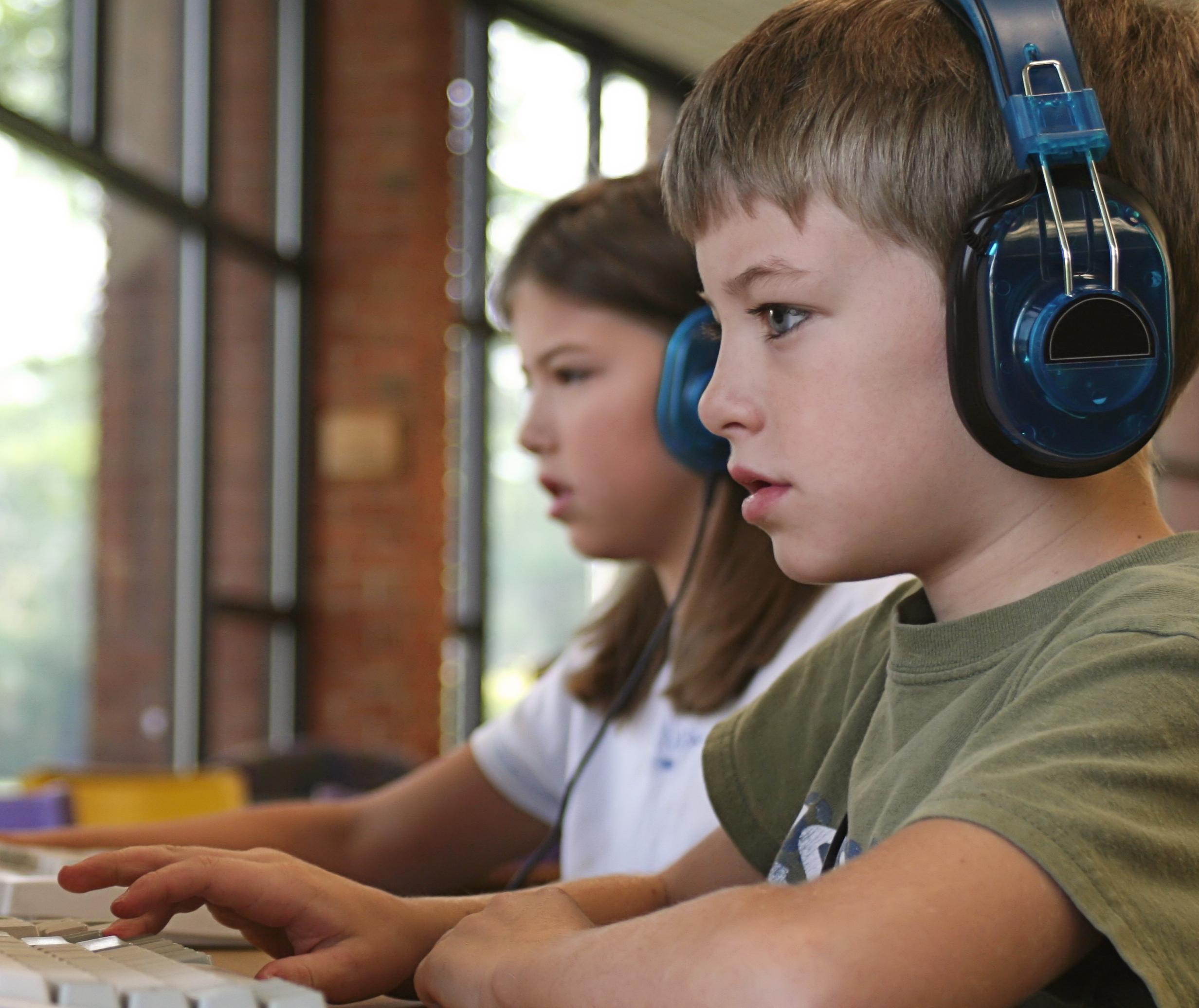 boy at reading lab computer